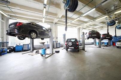 Concrete sealers for garage floors for Mechanic shop flooring